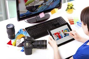 Photo editor working on computer.