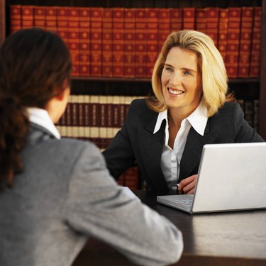 Close-up of two business colleagues having meeting
