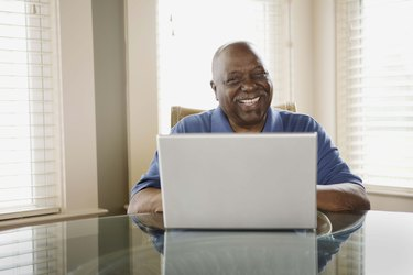 Man using laptop and smiling