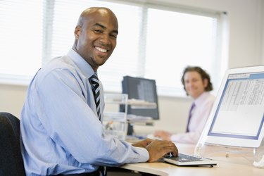 Businessmen working at desks