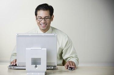 Hispanic man using computer at table