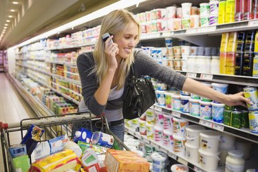 Woman on cell phone in supermarket