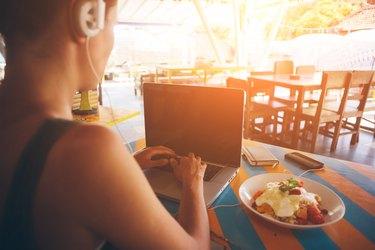 Freelancer working at laptop