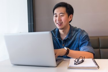 Asian handsome man in working space for creative jobs