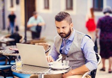 Hipster businessman in cafe