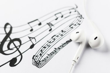 Earbuds on music notes