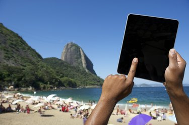 Brazilian Hands Using Tablet at Sugarloaf Rio de Janeiro Brazil