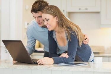 Man and woman chatting via webcam