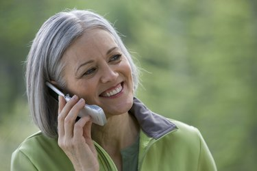 Close-up of mature man talking on mobile phone outdoors