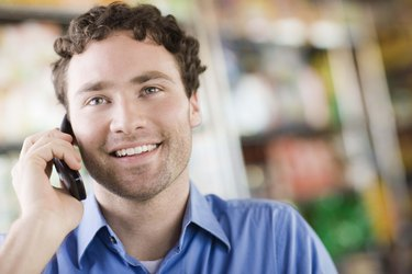 Man smiling on cell phone