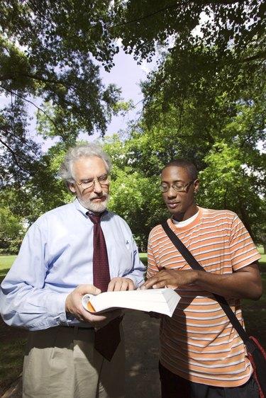 Professor helping student outdoors