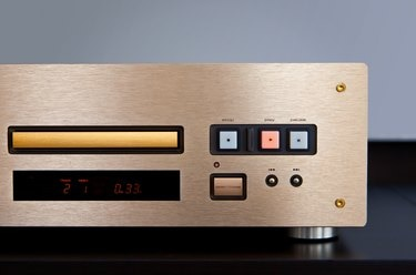 Expensive CD Player Playing Music with Golden Front Panel