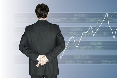 Stock broker with fingers crossed