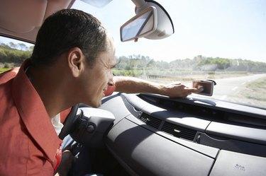 Man using GPS in car