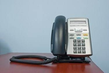telephone on desk in office