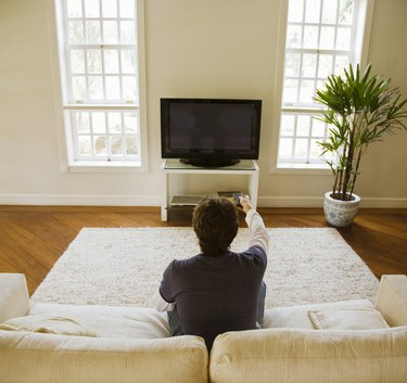 Man watching TV in modern living room