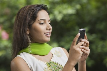 Woman using cellular phone