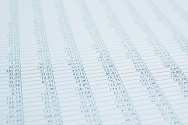 Business data financial report print close up. Blue toned.