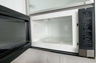 Open microwave oven in kitchen