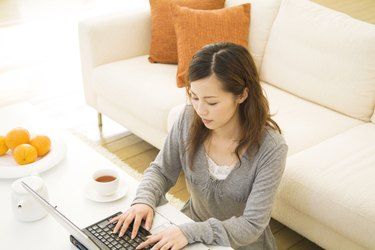 Woman using her laptop