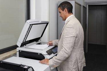 Businessman doing a photocopy
