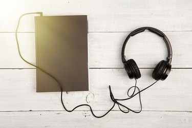 Audio book concept with black book and headphones