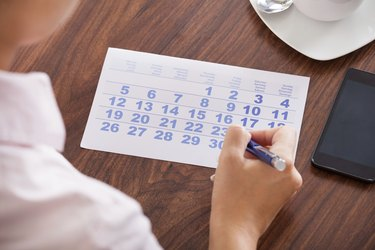 Businesswoman Marking In Calendar