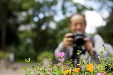 Senior man with camera