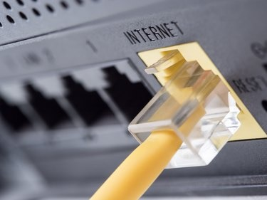 Yellow network cable connecting to the internet slot