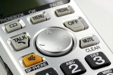 Silver cordless phone keypad closeup