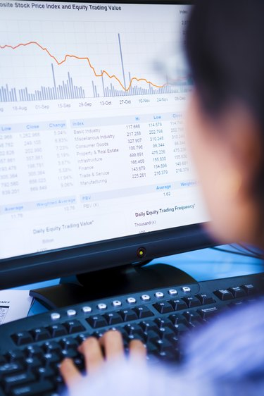 Broker examining stock drop