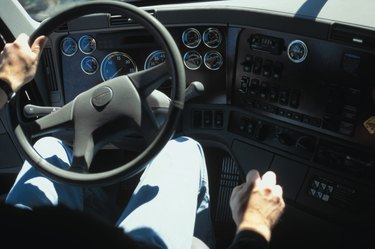 Interior view of man driving truck