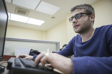 Young Man Working on PC