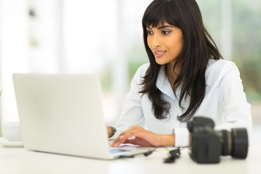 female photographer working on computer
