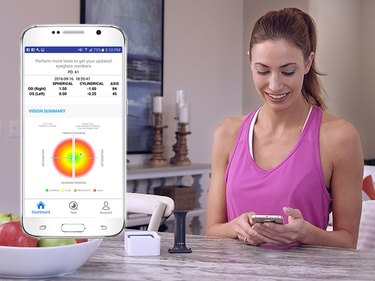Person checking EyeQue numbers on app.