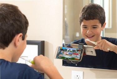 Boy using Grush gaming toothbrush