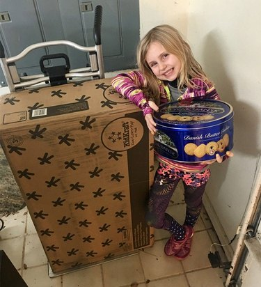 Megan Neitzel posing with the items ordered by Alexa