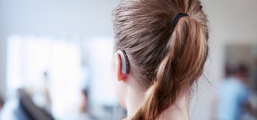 A woman wearing the ReSound ENZO2