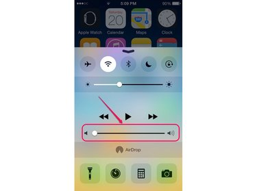 Adjust the volume through the Control Center.