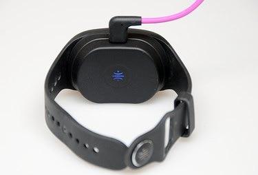The Healbe GoBe 2 in its magnetic charging cradle