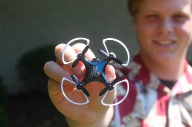 Photo of boy holding Vidius HD, the world's smallest live streaming HD video drone.