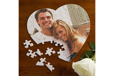 Photo of heart-shaped puzzle featuring photo of posing couple