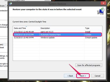The System Restore window, with a date selected and Next highlighted.