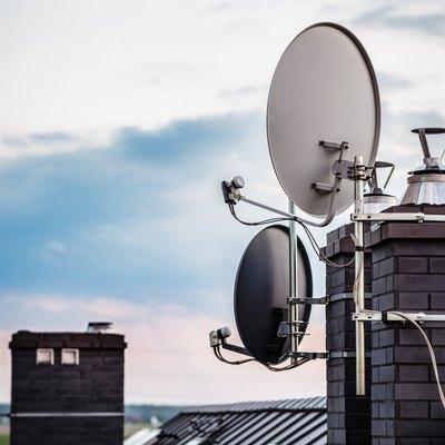 Satellite dishes, satellite antennas mounted on the chimney