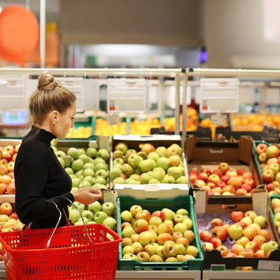 Woman buying fruits at the market