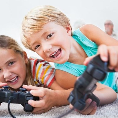Picture of kids playing with a gaming console