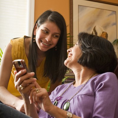 mother and daughter with cell phone