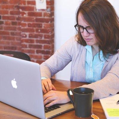 Woman working on Apple laptop