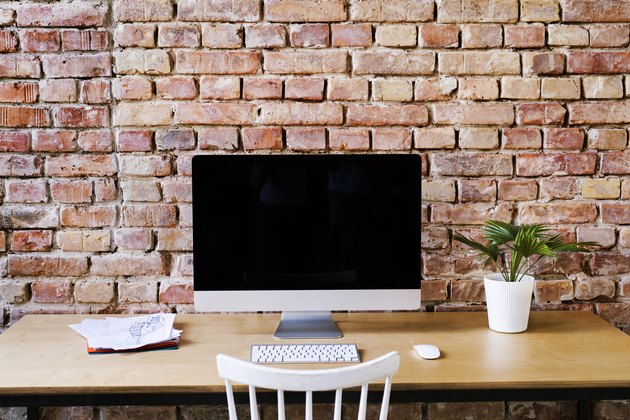 Workspace at brick wall in office