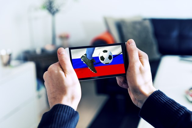 Mobile phone is streaming soccer on smart phone